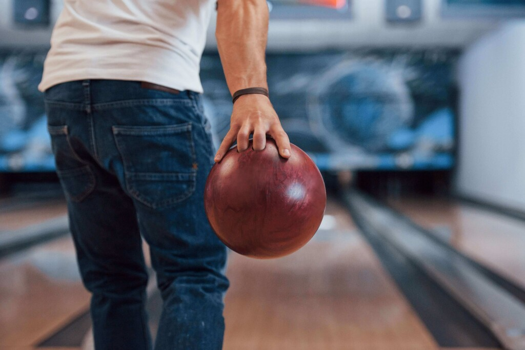 this-is-gonna-be-strike-rear-particle-view-man-casual-clothes-playing-bowling-club-min-1